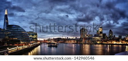 London at night , panoramic view from river. - stock photo