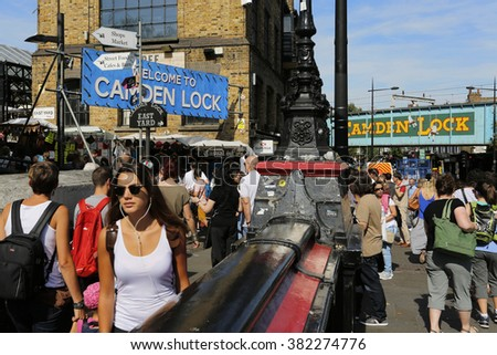 LONDON - AUGUST 22 : View of Camden Market, famous tourist attractions in Camden Town, also called Camden Lock, on Aug 22, 2015, London, UK. The Market attracting about 100,000 visitors each weekend. - stock photo