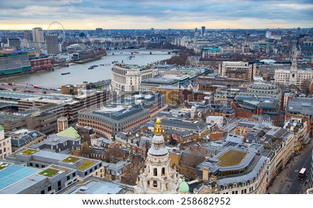 LONDON, UK - JANUARY 27, 2015: City of London, river Thames and beautiful sunset. London's panorama. View from the St. Paul cathedral - stock photo