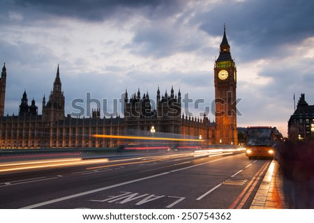 LONDON, UK - JULY 21, 2014: London eye in the night and south bank of river Thames, famous London's walk and tourist destination - stock photo