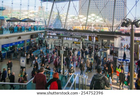 LONDON, UK - NOVEMBER 29, 2014: Stratford international train and tube station, one of the biggest transport junction of London and UK. Main hall with lots of people - stock photo