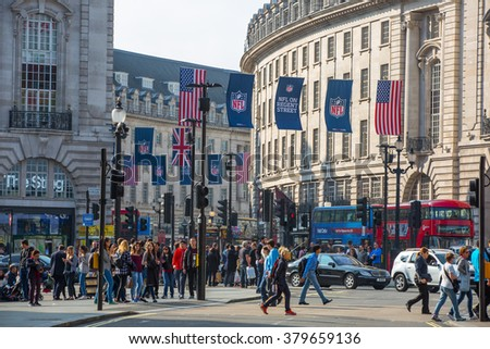 LONDON, UK - OCTOBER 4, 2015:  Regent street view with transport and walking people
