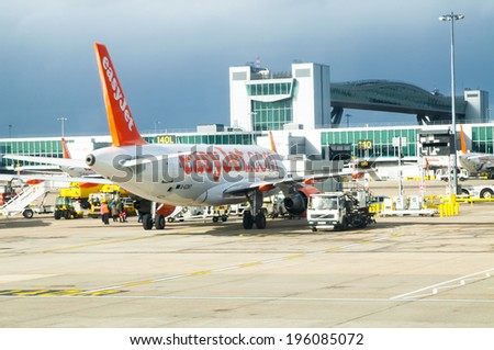 LONDON, UNITED KINGDOM - FEBRUARY 15, 2014: Easy Jet Plane in the Gatwick Airport in London on February 15, 2014, UK - stock photo