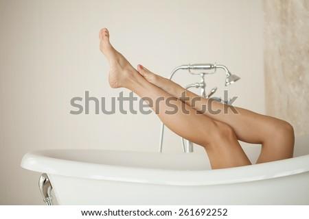 Long Woman Legs in Bath - stock photo
