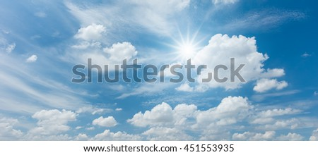 Looking up view of panorama blue sky with clouds and sun reflection