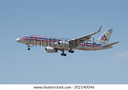 LOS ANGELES, CA/USA - JUNE 6 2015: American Airlines Boeing 757 (registration N690AA) shortly before landing at the Los Angeles World Airport (LAX). 'Flagship Freedom' special livery aircraft. - stock photo
