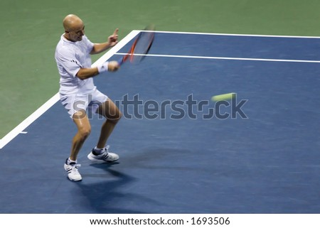 7-27-06 Los Angeles Countrywide Classic Tennis Tournament.  Andre Agassi returning at George Bastl in the second round