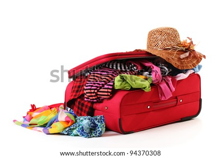 ?losed red suitcase with clothing isolated on white - stock photo