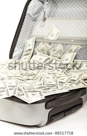 lot of money in a opened suitcase isolated on white - stock photo