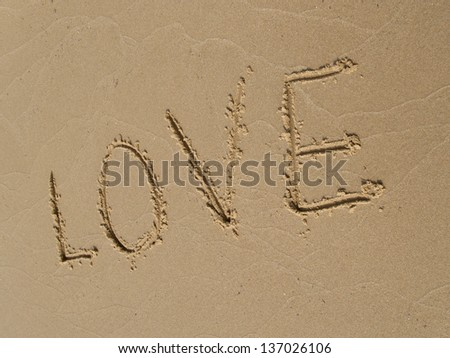 LOVE  inscription on a sandy beach