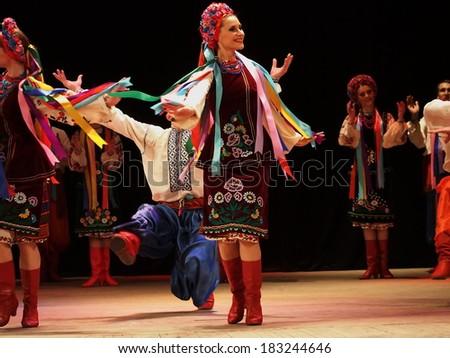 LUGANSK, UKRAINE - MARCH 18, 2014: Ukrainian National Folk Dance Ensemble named After P. Virsky, who is considered best folkloric ballet dancer in country, performed a live show on stage in Lugansk  - stock photo