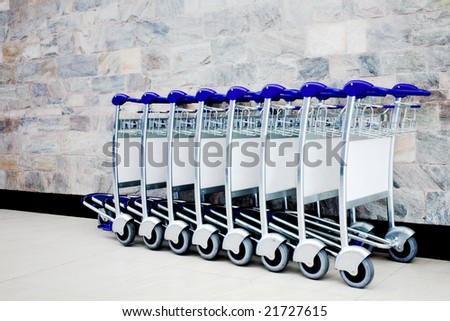 Luggage carts at international airport - stock photo
