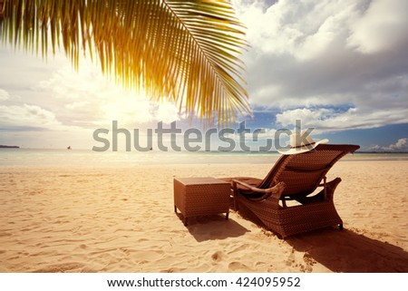 Luxury sunbeds on the beach, summer vacation  - stock photo