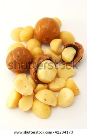 macadamia nuts on a white background - stock photo