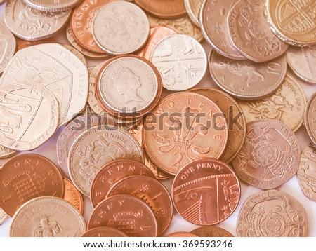 Macro image of British pound coins money vintage - stock photo