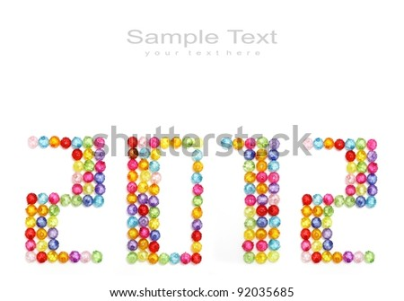 2012 made of colorful beads on white background