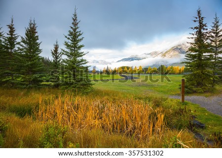 Magnificent fall in the Rocky Mountains.  Golf courses in Banff National Park - stock photo