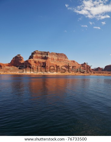 Magnificent Lake Powell. Picturesque red cliffs reflected in the smooth water of the lake - stock photo