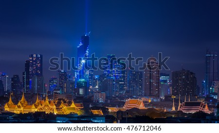 Mahanakhon bangkok rising lightshow, cityscape in night of Bangkok Thailand with wat phra kaew and Pho temple.