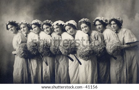 9 Maids a Cleaning - nine young, cleaning women with their dust mops. A circa 1900, vintage photograph. - stock photo