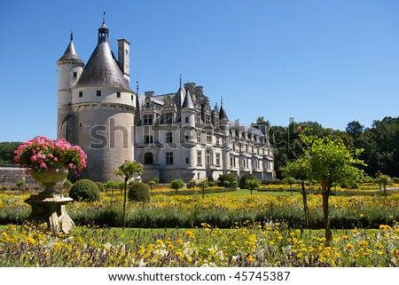 Majestic Chenonceau castle with its gardens in the front. - stock photo