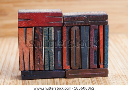 """Make love"" written with colored vintage letterpress (wooden background). Soft focus! - stock photo"