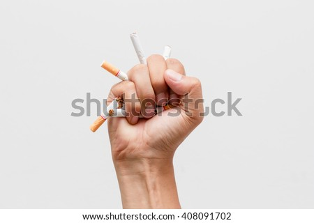 Male hand crushing cigarette, Concept Quitting smoking,World No Tobacco Day - stock photo