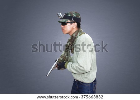 man aiming pistol gun - stock photo