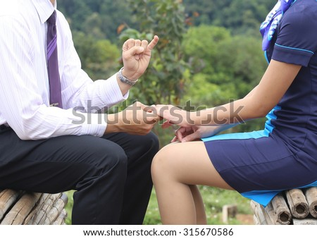 man apologize woman ,young man begging his girlfriend to forgive him, businessman - stock photo
