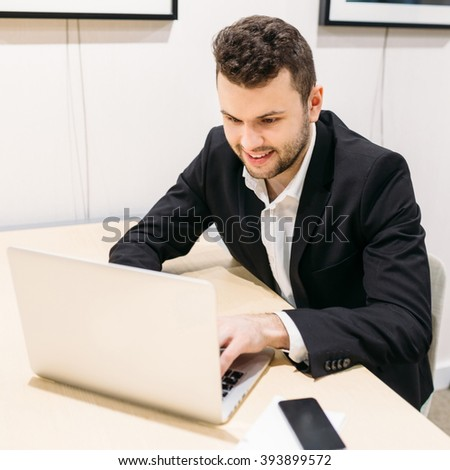 Man at the computer at work, businessman, office