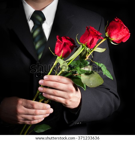 Man holding red roses. Valentine's day concept. - stock photo