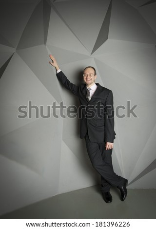 man in a suit and tie on the geometric background