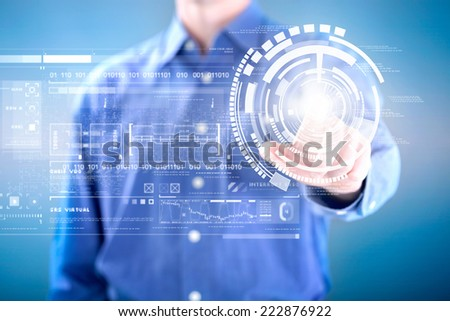 man pressing on button of digital virtual screen - stock photo