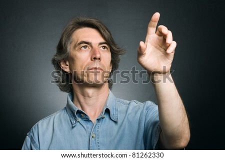 man pushing an imaginary button touch - stock photo