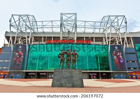 MANCHESTER, ENGLAND - JULY 6, 2014: Old Trafford stadium is home to Manchester United one of the wealthiest and most widely supported football teams in the world. - stock photo