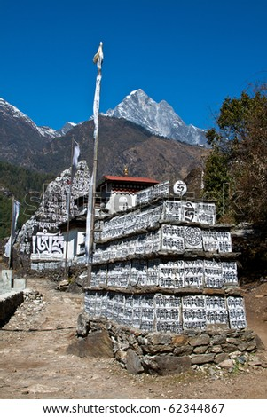 """Mani stones"" inscribed with the six syllabled Buddhist mantra of Avalokiteshvara. Khumbu Everest region, Nepal."