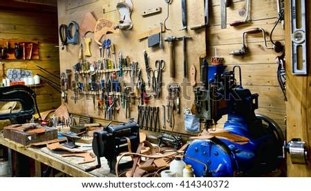 Mans old fashion  workshop. - stock photo