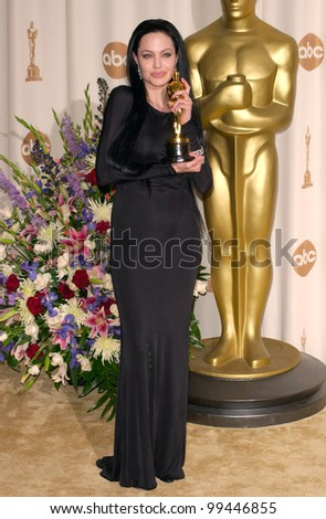26MAR2000:  Best Supporting Actress ANGELINA JOLIE at the 72nd Academy Awards.  Paul Smith / Featureflash
