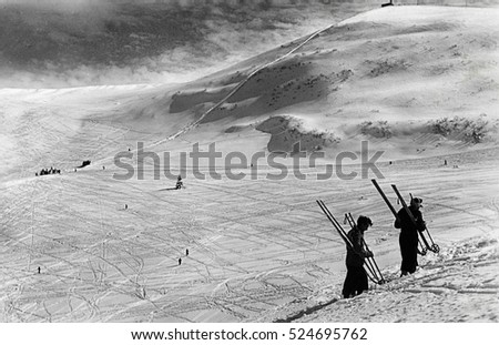 March1939, Monte Bondone, Italy - Holiday on ski: skiers climbing the mountainside with plenty of snow and a beautiful  view on the snow tracks. Scan, private family collection before WWII
