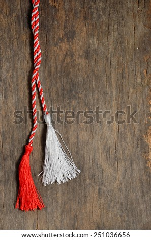 March 1 traditional trinket simbol with white and red silk or wool ropes - stock photo