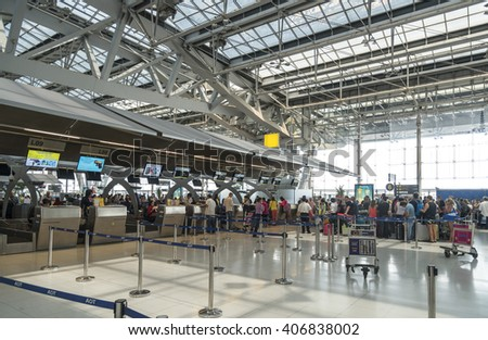 21 March 2016, Unidentified passengers arrive at the check-in counters at Suvarnabhumi Airport, Bangkok, Thailand - stock photo