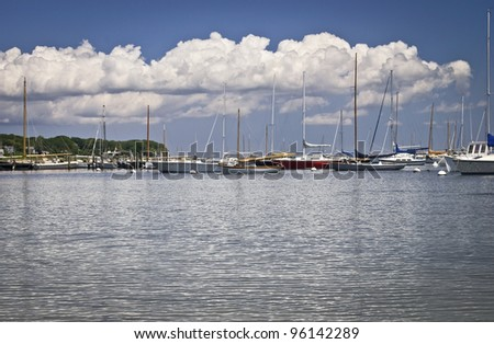 """Marina Cape Cod"" Sailboats on a sunny Summer day off Martha's Vineyard on Cape Cod in Massachusetts. - stock photo"
