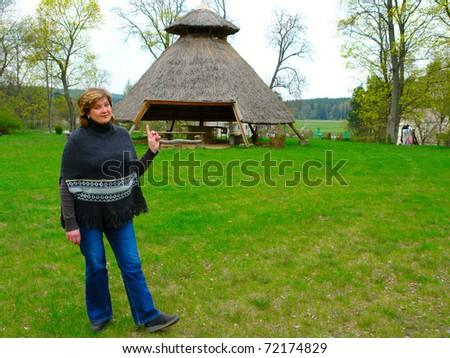 Mature woman near the gazebo in the park - stock photo