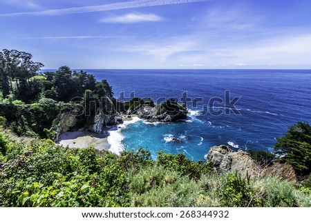 McWay Falls at Julia Pfeiffer Burns State Park on the Big Sur Highway (State Highway 1), on the California Central Coast, near Cambria, CA. - stock photo