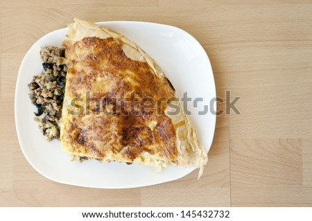 Meat pie with a beef filling on the white plate