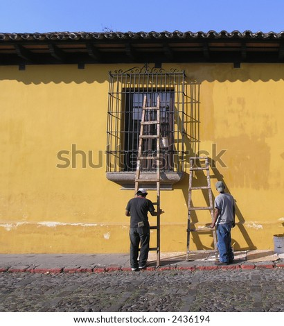 men painting house antigua - stock photo