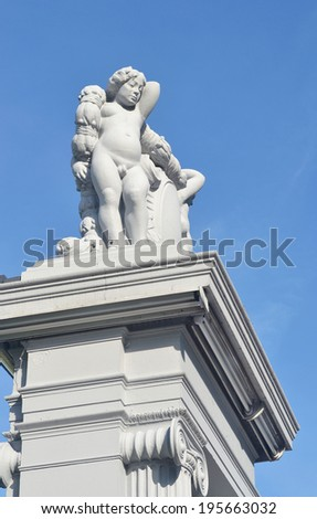 men  statue carving and blue sky - stock photo