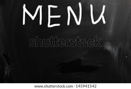 """Menu"" handwritten with white chalk on a blackboard - stock photo"