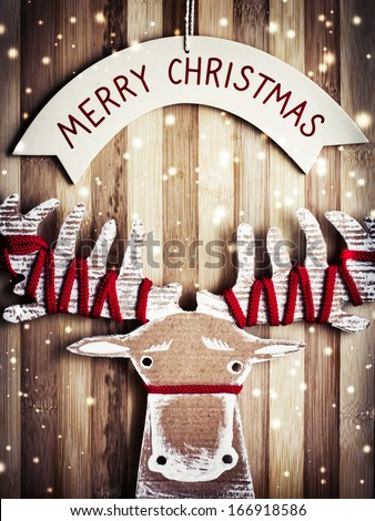Merry Christmas Card with christmas deer/christmas decorations over grunge background - stock photo