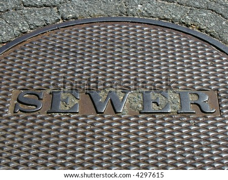 Metal sewer cover - stock photo